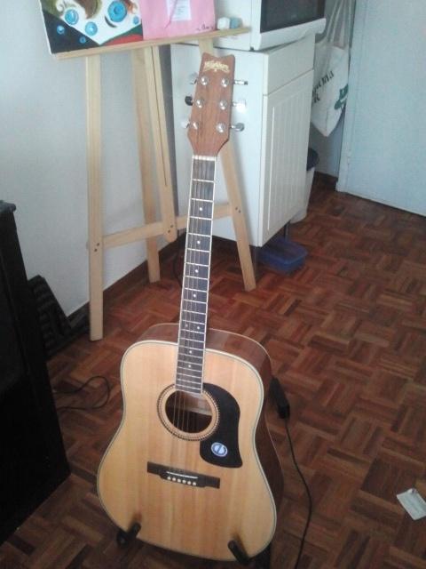 maravillosa guitarra acústica Waashburn Chicago con un sonido increible y casi nueva