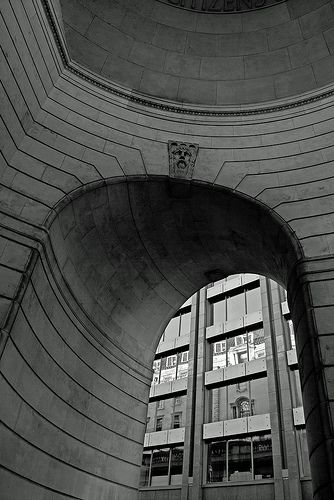 BankofEngland 0143 E The Bank of England, Threadneedle Street, London was designed by Herbert Baker and was completed in 1939. The current bank largey replaced one designed by Sir John Soane but parts of Soane's design remain including this corner dome known as 'Tivoli Corner', and the perimeter wall. The carving at the head of the arch is of Old Father Thames by Sir Charles Wheeler, Inside Tivoli Corner looking out onto Prince's Street.