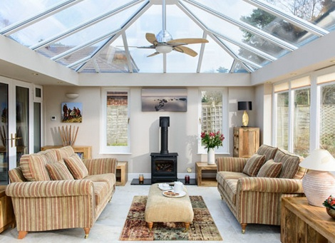 The inside view of an Anglian orangery with French Doors in White Knight