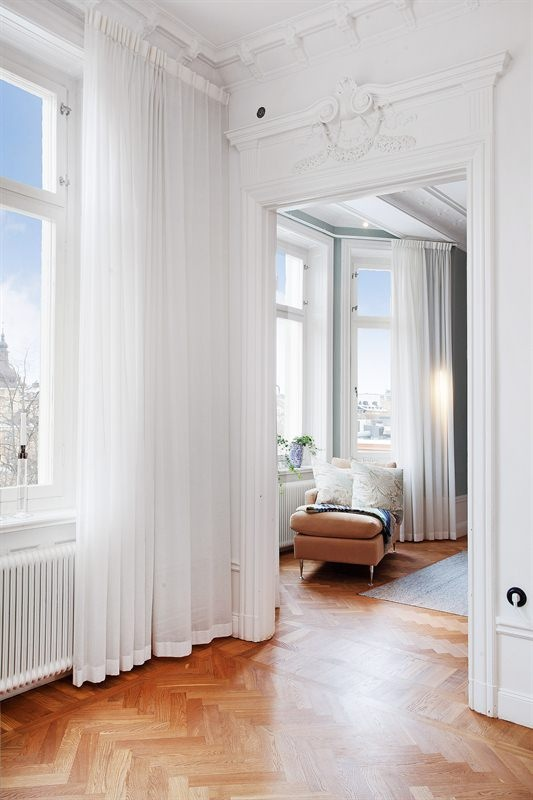 Wonderfully White white sitting area, great architectural details and moldings, parquet wood floor