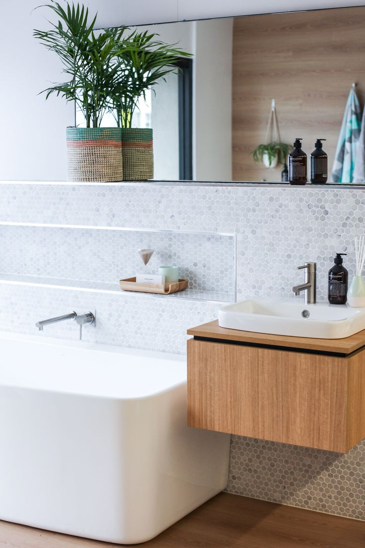 Fresh Bathroom styling! Featuring the Caroma Urbane Bath and Basin, and Caroma Titan stainless Steel Basin and bath mixer!