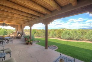 Southwestern Porch with exterior stone floors, Wrap around porch, outdoor pizza oven