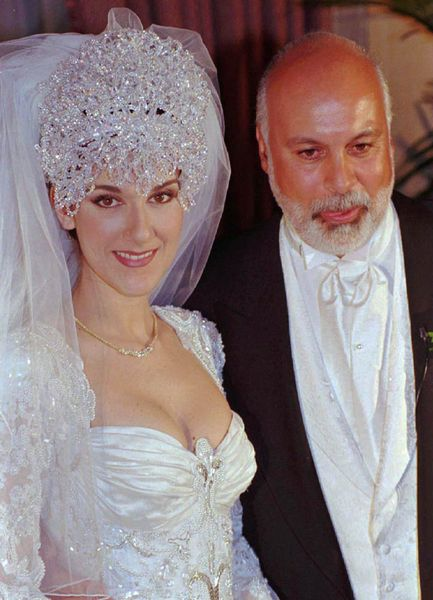 Celine Dion and Rene Angelil - wears a killing 20 feet train wedding dress and her head piece was made of Austrian crystals and says to weigh seven lbs.