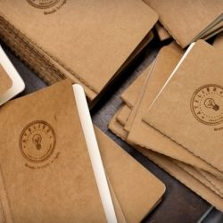 Someone's process for hot iron branding pocket-sized notebooks