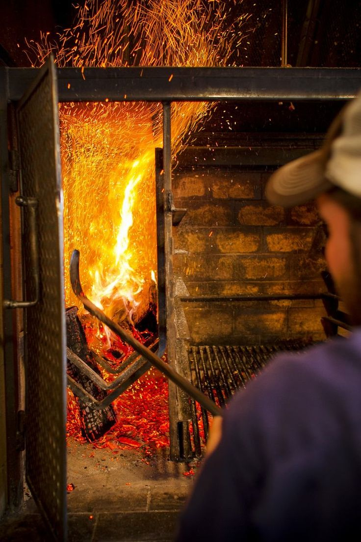 Wood-fired fish is a huge draw at Peche Seafood Grill in New Orleans. Photo via Peche Grill.