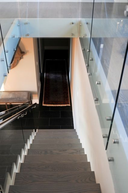 O2 Developments- Bearspaw renovation- Stairs with glass railing
