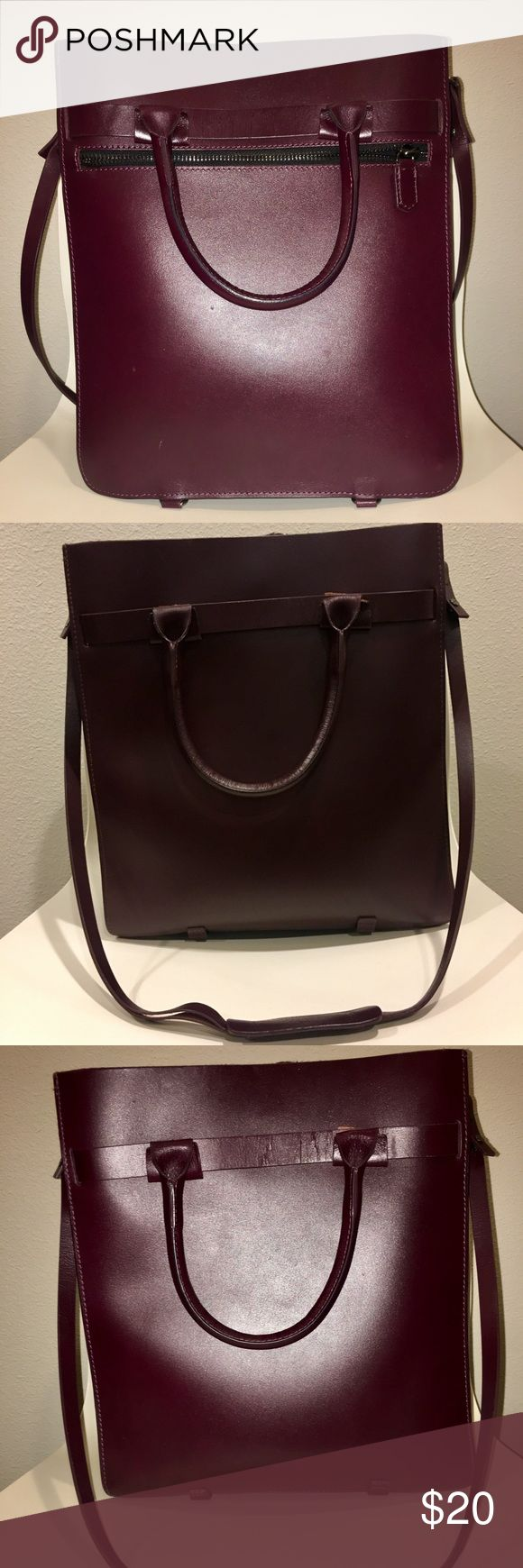 Structured Zara Tote Bag Very structured Zara tote bag. Great for laptops, binders and notebooks. The color is a dark plum. Beautifully structured bag! Zara Bags Totes