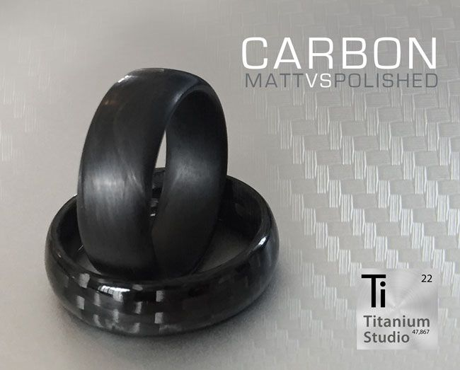 Full Carbon Fibre Wedding Rings.   Top Ring: Matt and Textured Carbon Fibre black ring. Bottom Ring: Polished Carbon Fibre  with Protective Resin Coating.