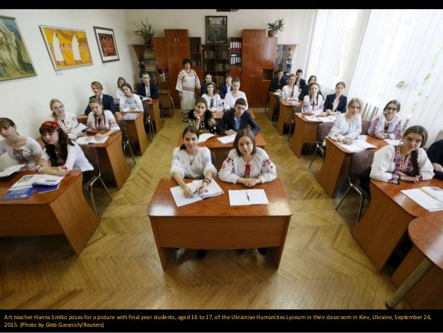 Art teacher Hanna Snitko poses for a picture with final year students, aged 16 to 17, of the Ukrainian Humanities Lyceum i...