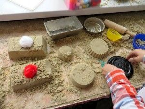Build a sand table large enough to borrow mom's kitchen pans if you don't have toy ones. (Skip the Teflon pans).