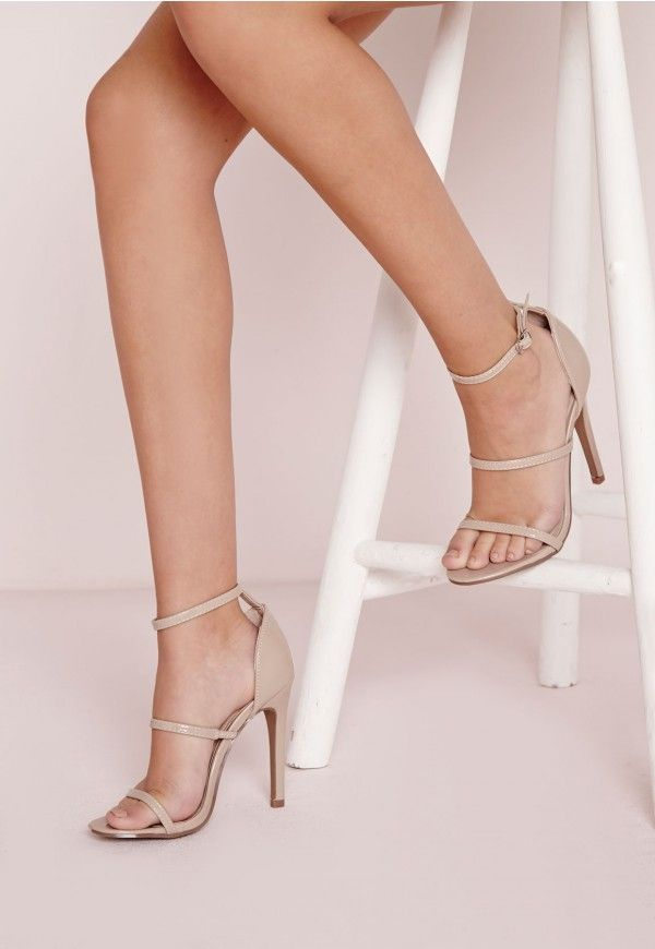 Work a classic look with this pair of heeled sandals. With a chic patent nude finish and three strap details, these barely there heels give a fresh minimal look. Rock this pair of style staples season after season at all of the hottest part...