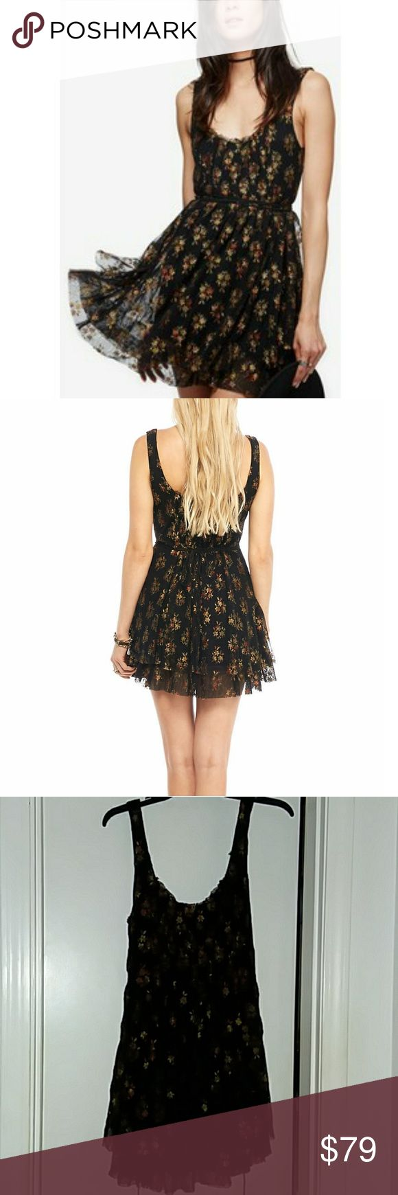 Free People NWT Heart Races Dress Adorable floral-printed mesh tank mini featuring a double-layered skirt, removable waist ties that form  crisscrosses, pleating at the bust, and seven buttons up the back. Raw edge hem. Poly/nylon with rayon liner. Machine washable.  Size medium in Black Combo. Including pics in a lighter color for better detail viewing. Free People Dresses Mini