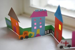 Have the kids cut out shapes tocreate the buildings..... make a street