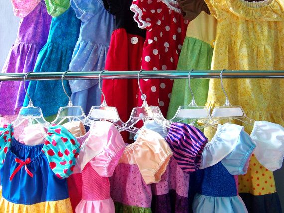 Princess dresses made from peasant style pattern with elastic neck and sleeves. Variations for Snow White, Rapunzel, Cinderella, Jessie, Belle, Tiana, Ariel, Mickey Mouse, Minnie Mouse, Cinderella's stepsisters,   Aurora