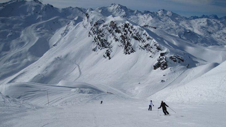 skiers on empty pistes