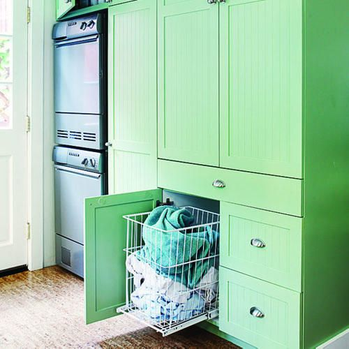 Hide laundry with basket on rollers in a cabinet
