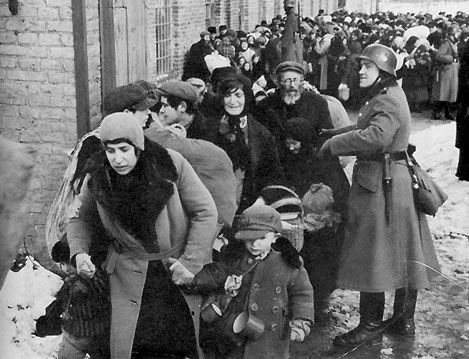 Jews from Lublin ghetto being hustled to the trains to be deported to Sobibor death camp, Poland, 1942.