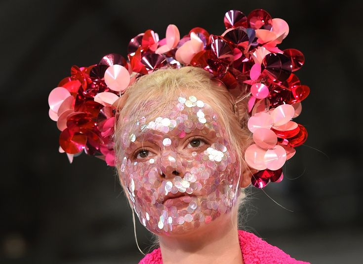 A model parades an outfit by Australian designer Akira Isogawa during Fashion Week Australia in Sydney on April 15, 2015