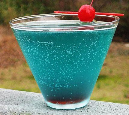 Shark Bite      (1 oz. Captain Morgan Spiced Rum  1 oz. Rum (light)  .5 oz Blue Curacao  1.5 oz. Sweet & Sour Mix  2 oz. Sprite  .25 oz Grenadine  Cherry for garnish)