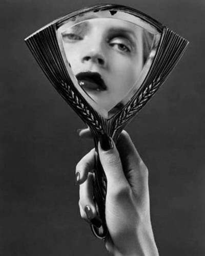 """""""She knew that the looking-glass never spoke falsely.""""/""""But mirrors have an uncanny way of telling the truth."""""""