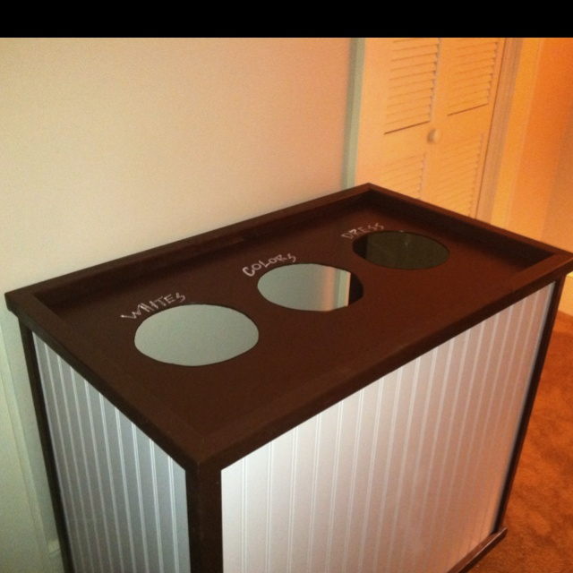 DIY Laundry Basket: A few 2x2s, bead board and paint, built to space dimensions. Tall laundry baskets underneath. $26. 