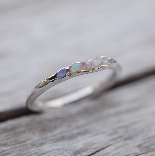 Opal Fossil Ring // Hidden Gems She's a vibrant thing. Flashes of colour, dripping with that zest for life that makes raindrops dance. They said she came to Earth riding a rainbow, and you can see why. She's your eye in every storm, never fails to make you smile. Both good and evil rush in her veins, and that's why you chose her.