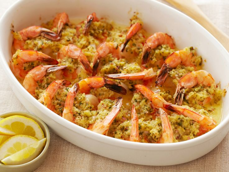 "Baked Shrimp Scampi : Assemble this whole dish in advance and then bake in just 10 minutes before dinner is served. One recipe reviewer remarked, ""I've always loved shrimp scampi, but this recipe delivers a scampi that is sweet, extremely tender and delicious. The panko gives the shrimp a delightful crunch, and the shrimp tails are nicely browned and eatable. This is certainly a 5-star appetizer."" via Food Network"