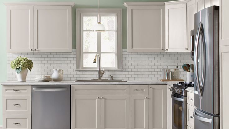 Kitchen with antique white shaker style cabinets crown for Grey green kitchen cabinets