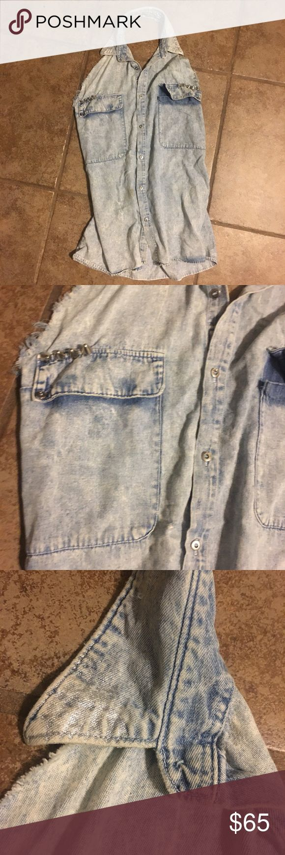 Backless denim dress Button up jean dress. Two pockets with studs on them. A collar with Silver tips. Perfect for festival season. Wears great with a pair of leggings J.F.Gee Dresses Backless