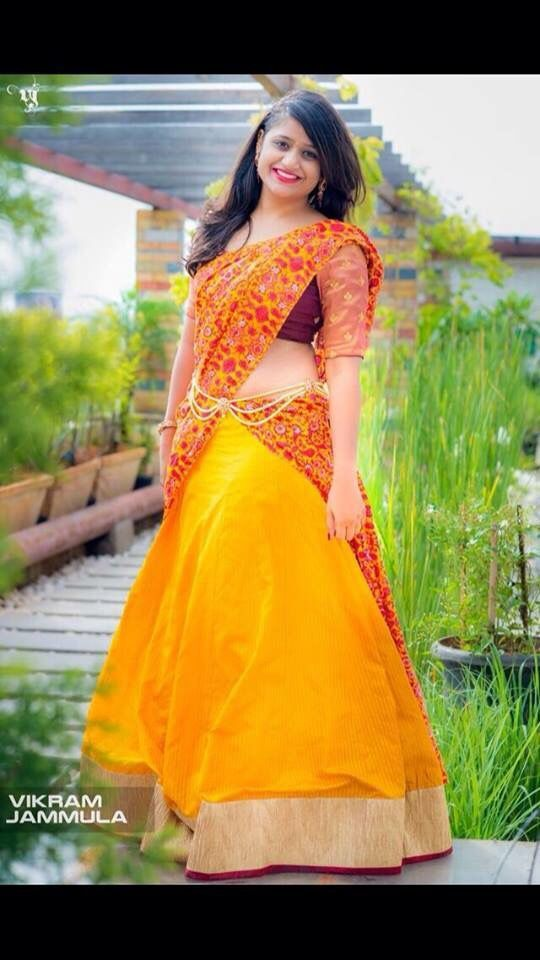 Designer half saree.. Yellow and maroon classic combo
