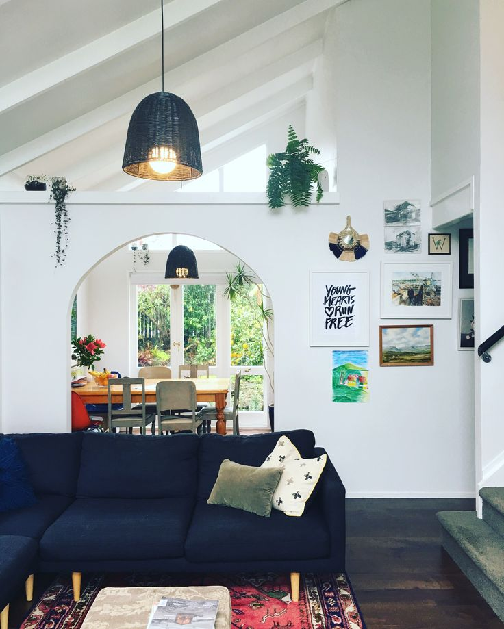 1970's interior - high ceilings, white walls and minimal furniture create the feeling of space in our 80sqm home.