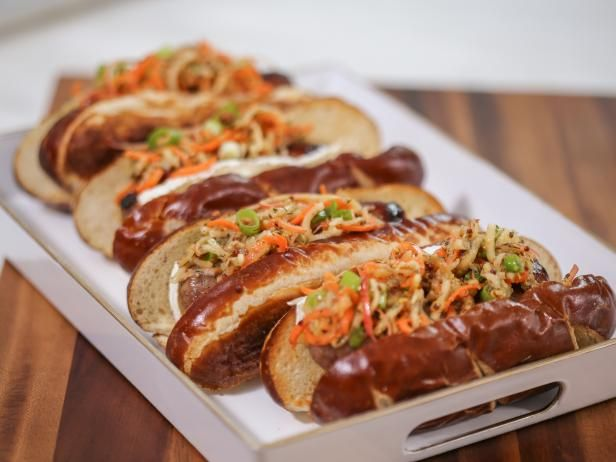 Get Grilled Bratwurst with Brie and Spiral Apple Slaw Recipe from Food Network
