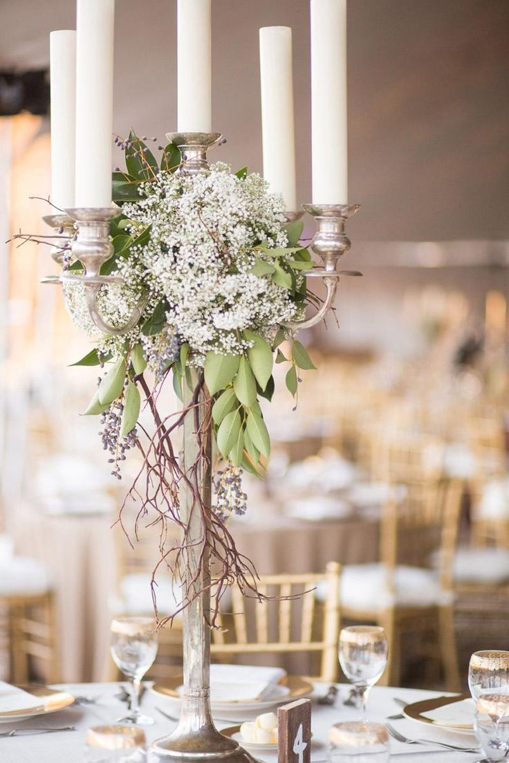 Silver Candle Stick w/Greens, Grape Vine & Baby's Breathe.  Great For Italian Theme or Garden Theme Weddins.  Stunning.