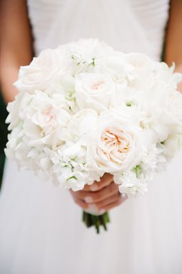 Wintry white wedding bouquet of hydrangeas, garden roses, ranunculus, and dendrobium orchids {Photo by Dear Wesleyann via Project Wedding}