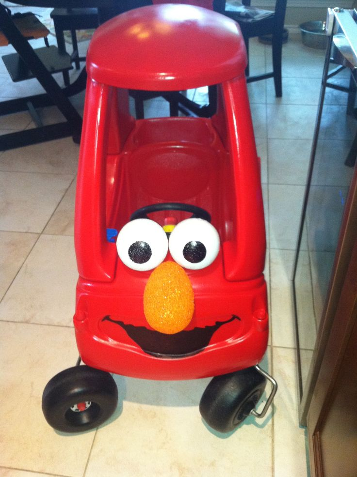 #Elmo Car!  8 year old Little Tykes coupe car spray painted red, styrofoam eyes and nose, mouth drawn on with sharpie!  Bday gift for Parker!