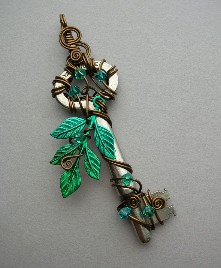 Water Tree Wire Wrapped Key Pendant -- Blue-green leaves, vintage bronze wire, green and blue Swarovski crystals. $56.00, via Etsy.
