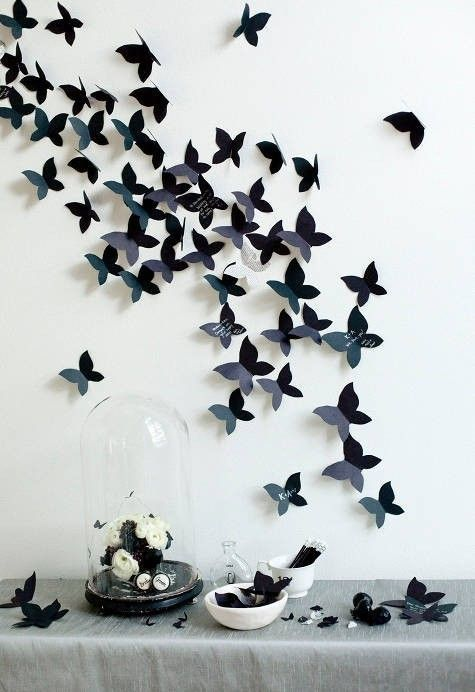 Butterfly Wall - Maybe not exactly something my husband would want in our living room but definitely the basis for a really good idea for cheap deco!