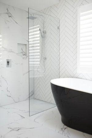 Herringbone and marble look tile making this black bath beauty pop - Three Birds Reno