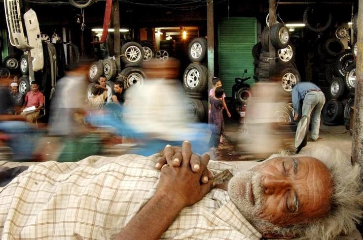 Raghu Rai INDIA A ricksawman taking a nap in Jama Masjid Market Delhi 2005.