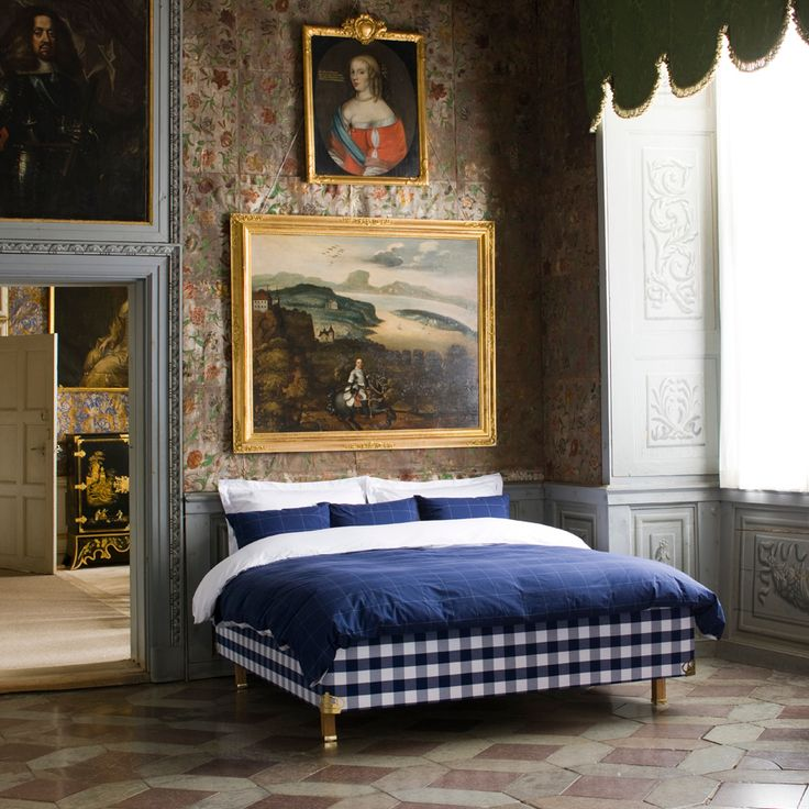 Geometric stone floor, floral wall covering, art, navy blue and white bed linen. ZsaZsa Bellagio.