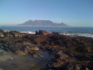 Table mountain from Melkbosstrand in cape town, South Africa. Can't wait to go this summer!!