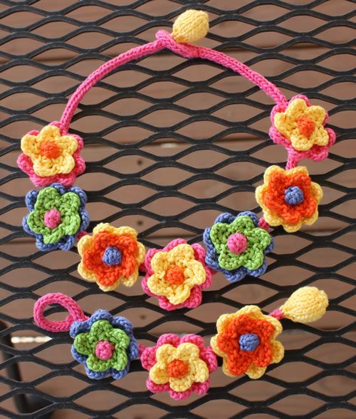 Abloom.  Knitted bracelet and necklace with instructions for free.