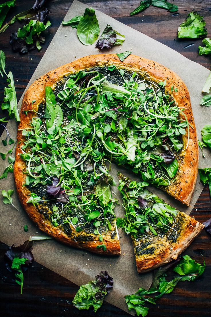 This green goddess pizza might be the best vegan pizza you'll ever have, with cashew cheese, pesto, topped with fresh greens and hemp seeds!