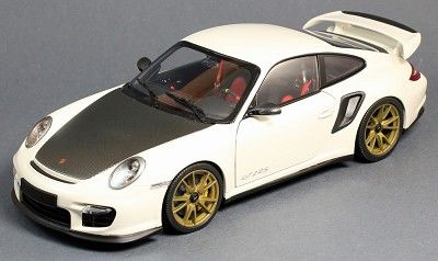 """2011 Porsche 911 GT2 RS in White with Gold Wheels.  Minichamps replicates the real car with this 1:18 scale diecast that will be a great addition to your collection.  This diecast car measures approximately 9.5"""" long.  Total production on this diecast car is 504 pieces worldwide.  Click on the picture for more information about this diecast car!"""