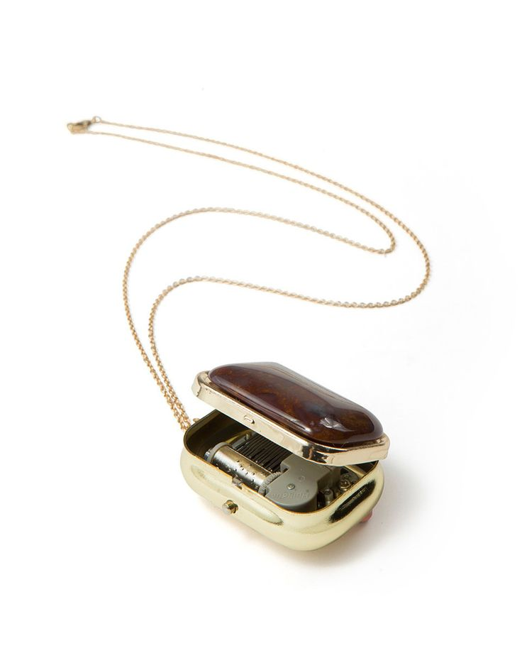 @Robin Wade OMG, this brown stone pendant is an actual working music box!