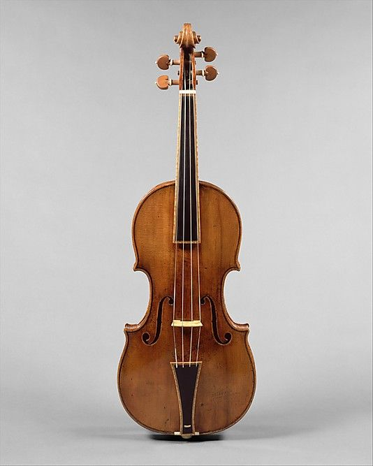 """""""The Gould"""" by Antonio Stradivari (Italian, Cremona 1644–1737 Cremona) This Antonio Stradivari violin is the only one in existence that has been restored to its original Baroque form. Before modification to produce a louder, more brilliant tone and to extend the left-hand technique to higher positions, Baroque violins had gut strings, a short fingerboard, and a neck angled back only slightly from the body. Today, few fine violins show these original features."""
