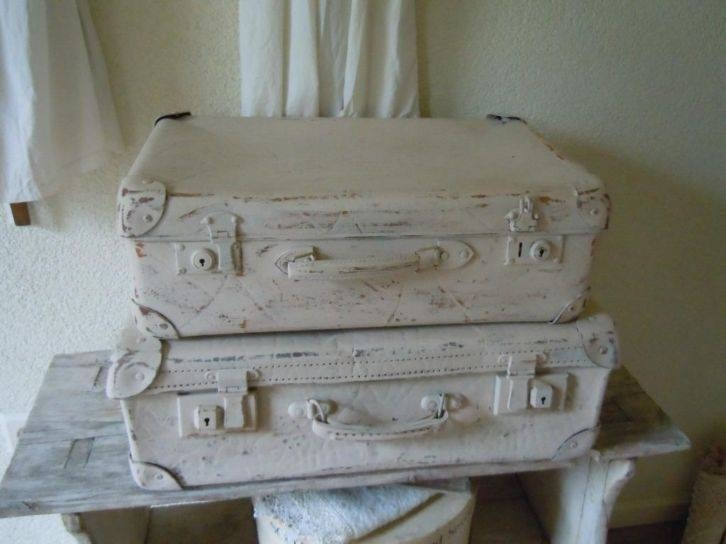 paint old suitcases white and stack them