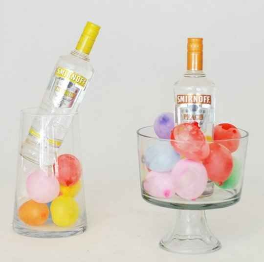 Keep drinks cold with frozen water balloons.