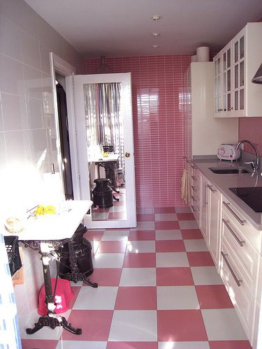This flooring would be cool in the right bathroom too! modern-pink-kitchens-5