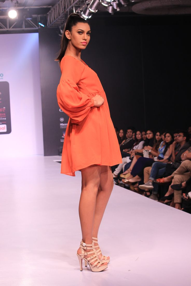 #Oxolloxo redefines simplicity through this #orange frock teamed with white #pumps